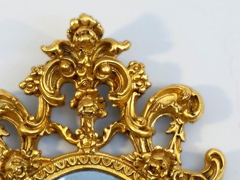 vergoldeter Speigelrahmen mit Krone